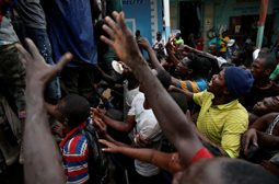 People assail a truck to try to get food after Hurricane Matthew hit Jeremie, Haiti, October 14, 2016. REUTERS/Carlos Garcia Rawlins
